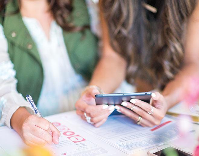 internal-news-young-women-cell-phone/